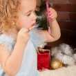 Little blonde girl with lipstick and mirror — Stock Photo