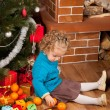 Stock Photo: Little girl near Christmas tree