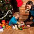 Mother and her daughter near Christmas tree - Foto de Stock