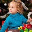 Little girl near Christmas tree — Stock Photo