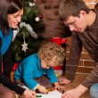 Happy family near Christmas tree - Stockfoto