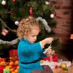 Little girl near Christmas tree — Stock Photo #7960918