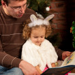 Little girl with her dad near Christmas tree — Stock Photo