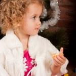 Preaty little girl eating tangerine — Stock Photo #7961029