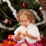Preaty little girl eating tangerine — Stock Photo #7961067