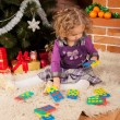 Little girl play near Christmas tree — Stock Photo #7961080