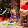 Little girl play with dad  near Christmas tree — Стоковая фотография