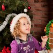 Little girl play near Christmas tree - Foto de Stock