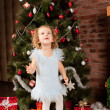 Little girl staying near Christmas tree - Foto de Stock