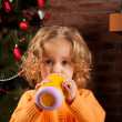 Pretty girl drinking from baby cup — Foto de Stock