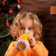 Pretty girl drinking from baby cup — Foto Stock