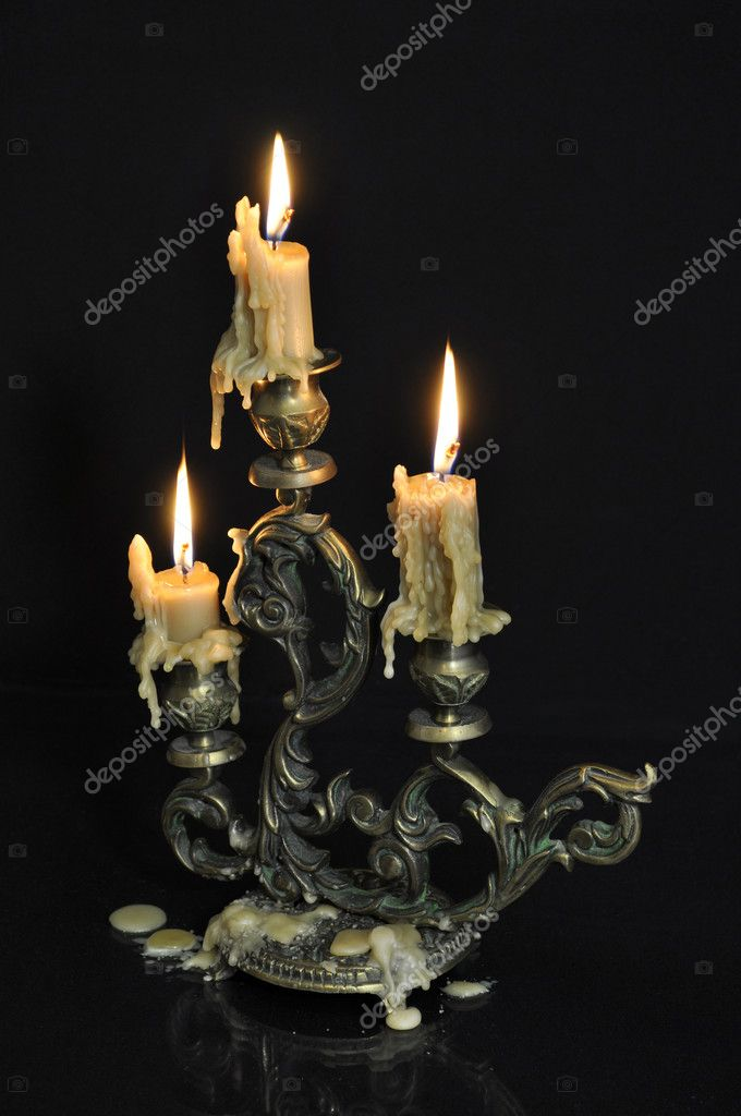 Antique candelabra with three melting candles on black background — Стоковая фотография #7359732