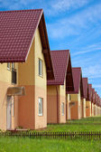 Townhouses with household lawns — Stock Photo