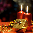 Christmas candles and gift boxes — Stock Photo