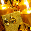 Gold christmas candles and gold gift boxes — Stock Photo #6771878