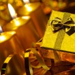 Gold christmas candles and gold gift boxes — Foto de Stock