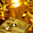 Gold christmas candles and gold gift boxes — Stok fotoğraf