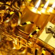 Gold christmas candles and gold gift boxes — Stockfoto