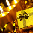 Gold christmas candles and gold gift boxes — Stock fotografie