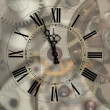 Old hours with figured arrows on mechanism blur background — Stok fotoğraf