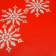 The big snowflake on a red background — Stock Photo