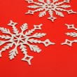 Stock Photo: The big snowflake on a red background