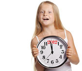 The girl hold in hands a big clock with figures 2012 — Stock Photo