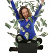 The woman in front of the laptop with fly out dollars — Stock Photo