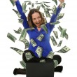 The woman in front of the laptop with fly out dollars — Stockfoto