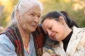 The grandmother with the grand daughter — Stock Photo