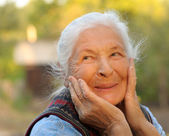 Portrait of the laughing elderly woman — Stock Photo