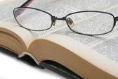 Eyeglasses on the old opren book — Stock Photo