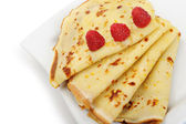 Crepe on a plate with a raspberry — Stock Photo