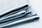 Heap of newspapers. Blue toned — Stock Photo