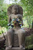 Buddha decorated with flowers — Stok fotoğraf