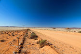 Road through a vast, arid landscape - horizontal — Stock Photo