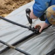 Craftsmen combines geothermal pipes in the ground — Stock Photo