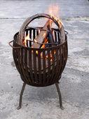 Fire in a metal fire basket — Stock Photo