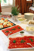 Buffet with tomato and fruit — Stock Photo