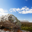 Stock Photo: Rocks and vast steppe landscape