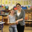 Stock Photo: Smiling student and teacher in the classroom