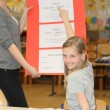 German teacher and pupil hours in the classroom to learn togethe - Stock Photo