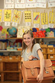 Happy girl at school with school bag. — Stock Photo