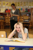 Overburdened student in the school — Stock Photo