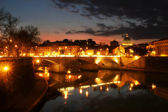 Tiber river and night illuminated Vatican city at evening. — Stock Photo