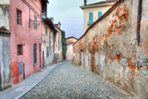 Narrow paved street among houses in Saluzzo, Iyaly. — Stock Photo