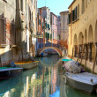Boats on canal among houses in Venice, Italy. — Stock Photo
