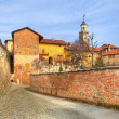 Old houses and paved street in Saluzzo, Italy. — Stock Photo