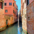 Narrow canal among old houses in Venice, Italy. — Stock Photo