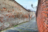 Small street among old walls in Saluzzo, Italy. — Stock Photo